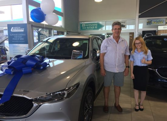 Bill taking delivery of a Mazda CX5