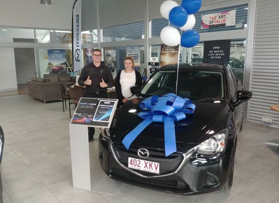 Melissa taking delivery of a Mazda Mazda 2
