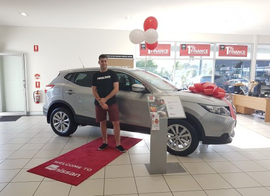 Aidan taking delivery of a Nissan Qashqai