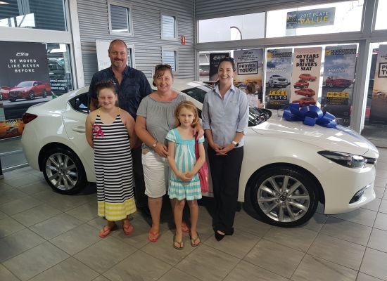 Roser Family  taking delivery of a Mazda Mazda 3