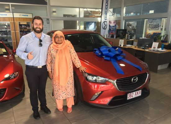Kausar taking delivery of a Mazda CX3