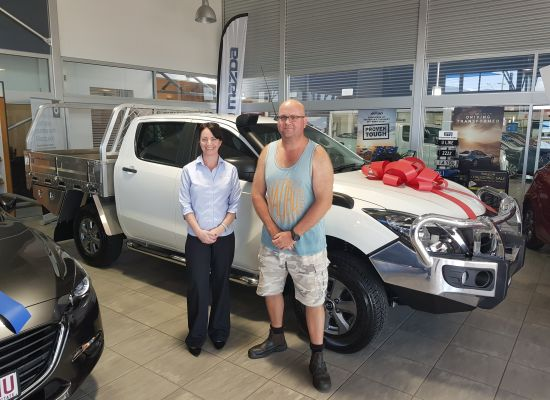 Udo taking delivery of a Mazda BT50