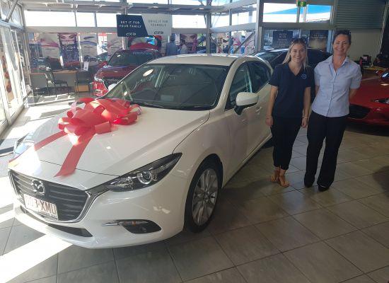 Taelah taking delivery of a Mazda Mazda 3