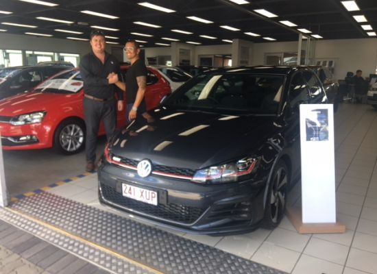 Mhelvin taking delivery of a Volkswagen Golf