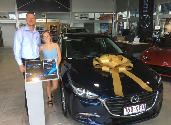 Tess taking delivery of a Mazda Mazda 3
