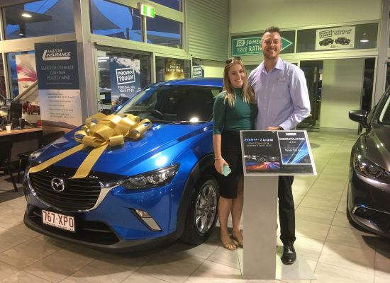 Lily taking delivery of a Mazda CX3