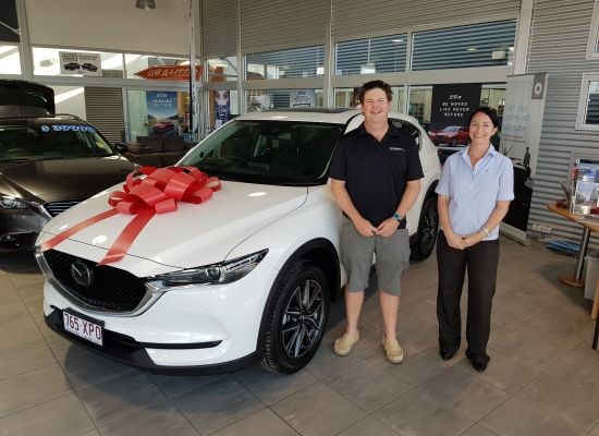 Greg taking delivery of a Mazda CX5