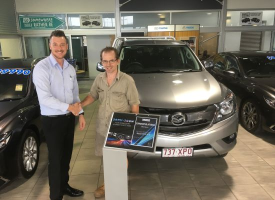 Mick taking delivery of a Mazda BT50