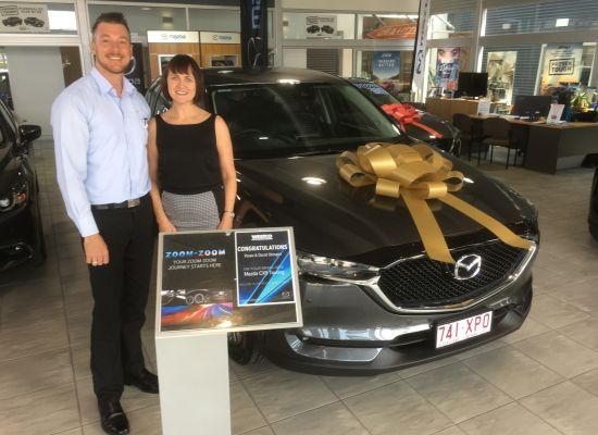 Rosie taking delivery of a Mazda CX5