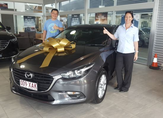 Young taking delivery of a Mazda Mazda 3 | Westco Motors Cairns