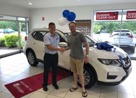 Ben taking delivery of a Nissan X-Trail