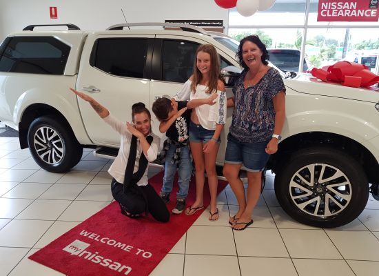 Janice & family taking delivery of a Nissan Navara