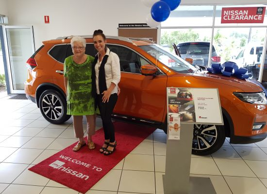 Heather taking delivery of a Nissan X-Trail