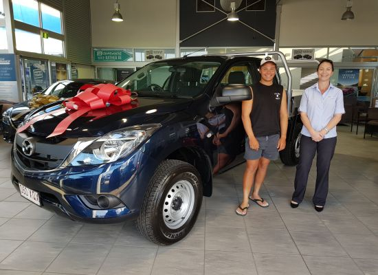 Alexander taking delivery of a Mazda BT50
