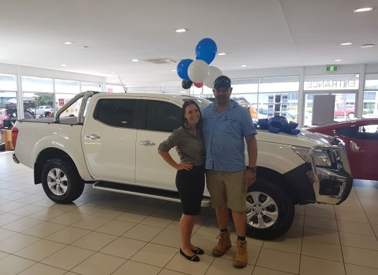 Yoggie taking delivery of a Nissan Navara