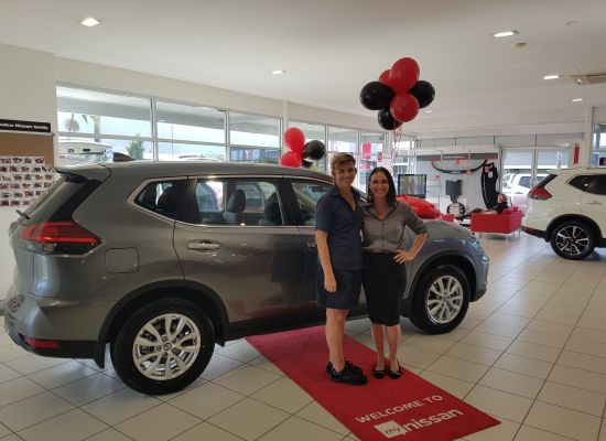 Julie taking delivery of a Nissan XTrail