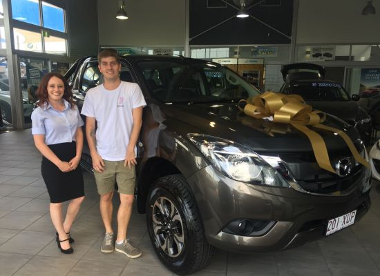Samuel taking delivery of a Mazda BT50