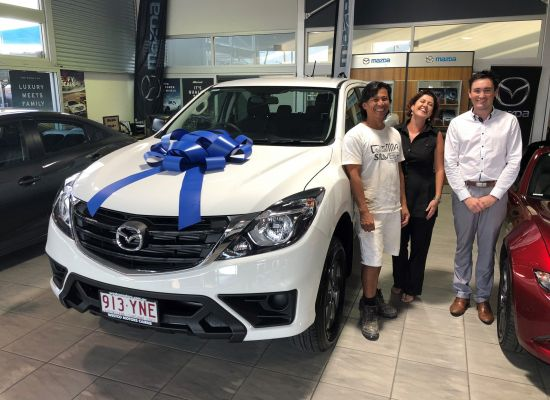 Agung taking delivery of a Mazda BT-50