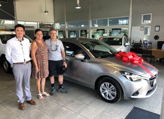 Boris and Katherine taking delivery of a Mazda Mazda 2 Neo