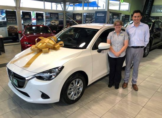 Mandy taking delivery of a Mazda 2