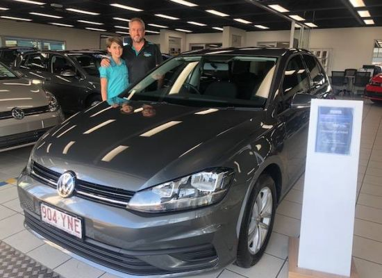 Steve taking delivery of a Volkswagen Golf
