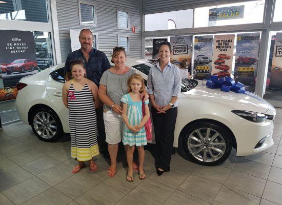 Roser Family  taking delivery of a Mazda Mazda 3