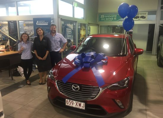 Brigitte taking delivery of a Mazda CX3