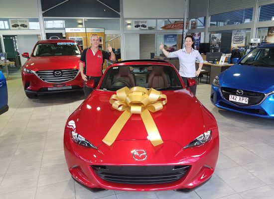 Michael taking delivery of a Mazda MX5
