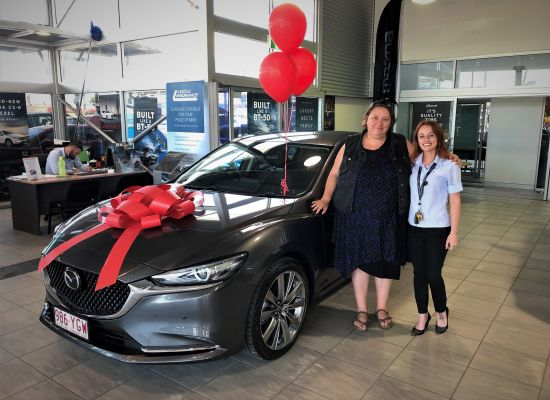 Cass taking delivery of a Mazda 6 GT