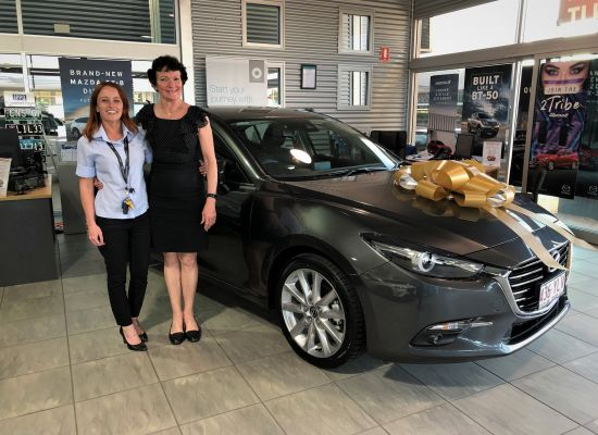 Cathy taking delivery of a Mazda 3 SP 25