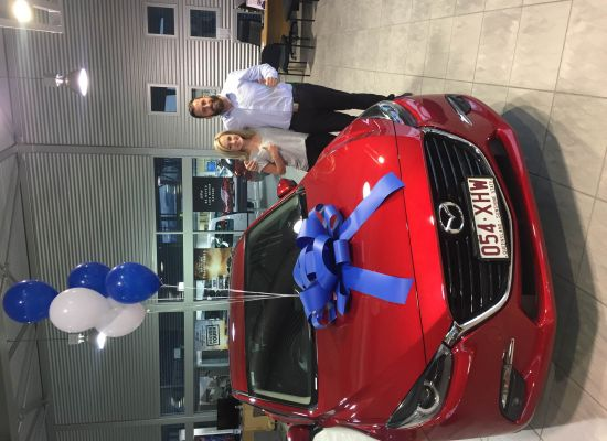 Holly taking delivery of a Mazda Mazda 3