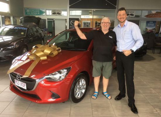 Ross taking delivery of a Mazda Mazda2