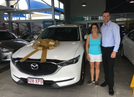 Margaret taking delivery of a Mazda CX5