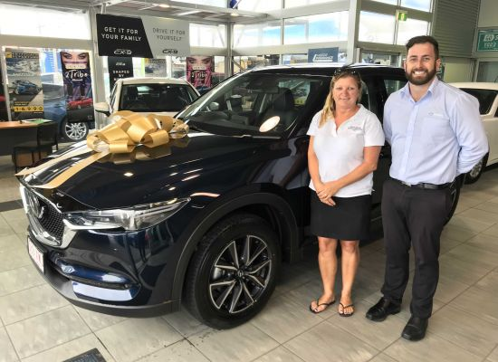 Lisa taking delivery of a Mazda CX5